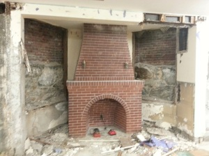 The Children's Fireplace shows the old outside wall, the rubble foundation and the interior concrete foundation.