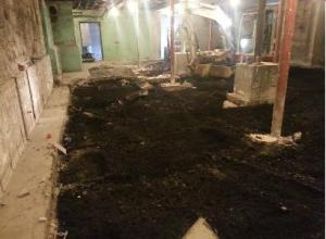 Floor slab removed to make way for a drainage system and provide a floor that will keep out the water.