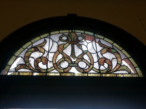 Stained glass window discovered under plywood repair above the old main entrance to the Shute Library.