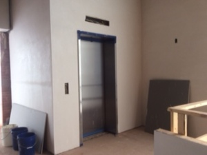 Dry wall began going up - Here it is around the elevator.