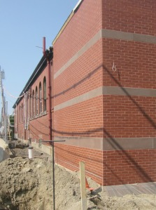 Beautiful brickwork blends the new addition with the historic building.  This photo picks up a shadow which will not be there when construction barriers and wiring is removed.