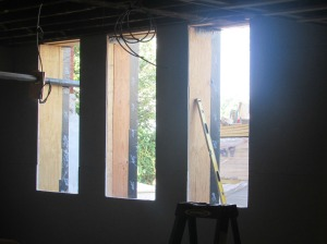 Nice, big windows will be installed here, replacing the tiny ones that peeked out of basement wells.