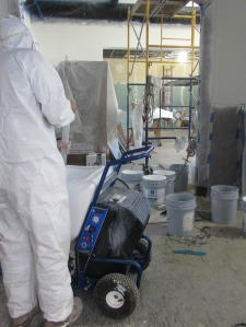It's a messy job but a coverall helps keep paint where it belongs - on the wall.