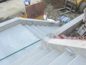 Outside, the lower stair case has been completed.