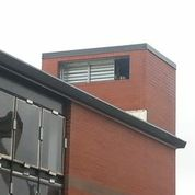 Look up and you will see the top of the new elevator enclosed to look like a chimney.