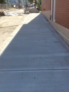A nice even sidewalk now borders the Gledhill side of the new addition.
