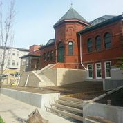 """Concrete pours completed the """"hardscape"""" in front of the library."""