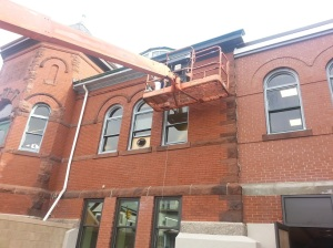 Work on the gutters and the brickwork takes someone without a fear of heights.