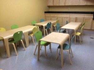 Story craft room with new tables and chairs.